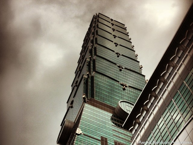 Taipei 101, once the world's tallest building, under a dramatic sky