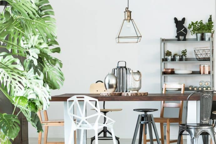 space with metal shelf and wooden table - 5 rules in Interior Design that we are begging you to break!
