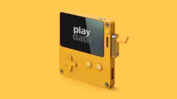 Playdate, a mini game console with a handle.