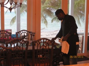 Chef Demeko setting the table for the Romantic Dinner for Two at Camp David.