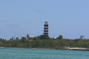 View of the lighthouse from across the harbour in Hope Town
