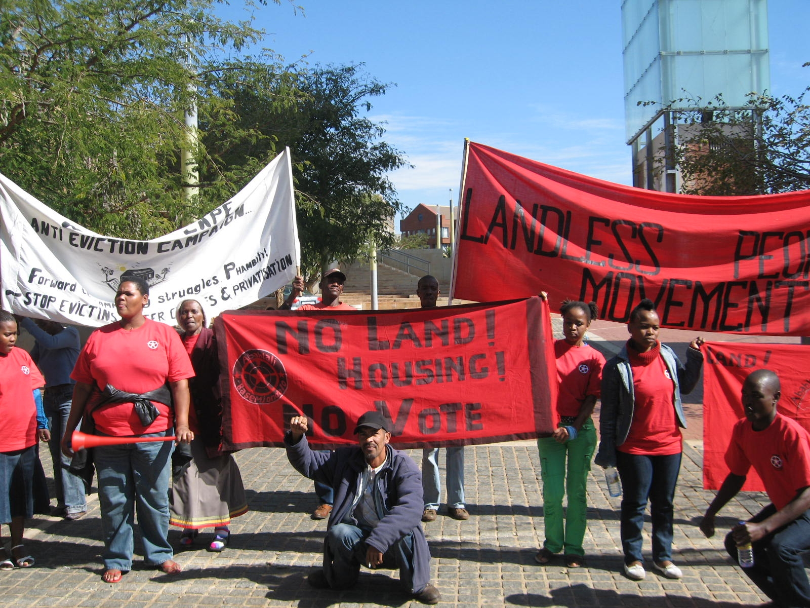 Anti-Eviction Campaign, Abahlali baseMjondolo and Landless Peoples Movement banners outside the Constitutional Court