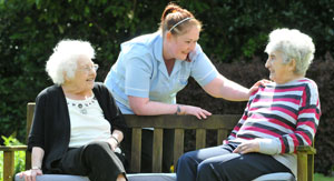 Abbeyfield Newcastle residential care homes buddy scheme residents on park bench