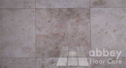 dirty holes make travertine tiles look ugly