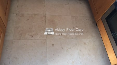 travertine tiles in balderton newark with holes filled with soil