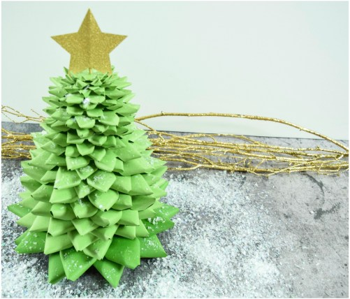 since christmas is a great time to create something new i decided to go for a new approach to a small decorative christmas tree using paper in this diy