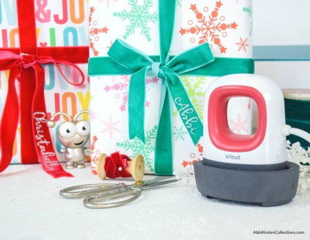Personalized Christmas Gift Tags with Velvet Ribbon Bows. Use the Cricut Easypress Mini and iron-on vinyl to customize gift bows with your recipient's name.