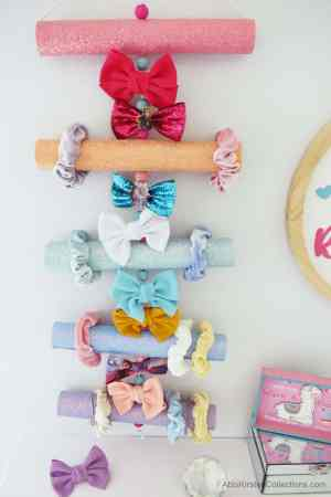 Hair bow and accessories holder made from cardboard tubes.