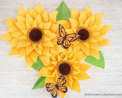 How to make giant paper sunflowers for backdrop decor. Step by step large sunflower tutorial. Sunflower SVG cut files and pdf printables.