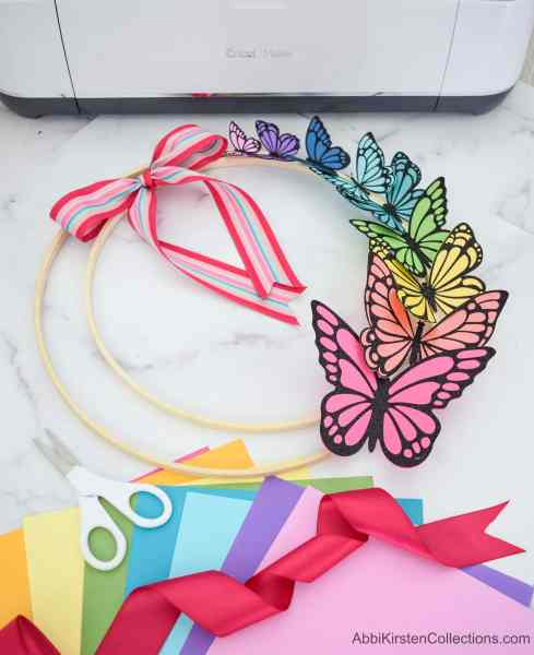 How to use your cricut machine to make paper butterflies for a spring wreath project.