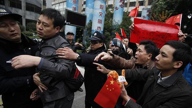El medio chino en huelga acepta volver al trabajo a cambio de la dimisión del jefe de Propaganda