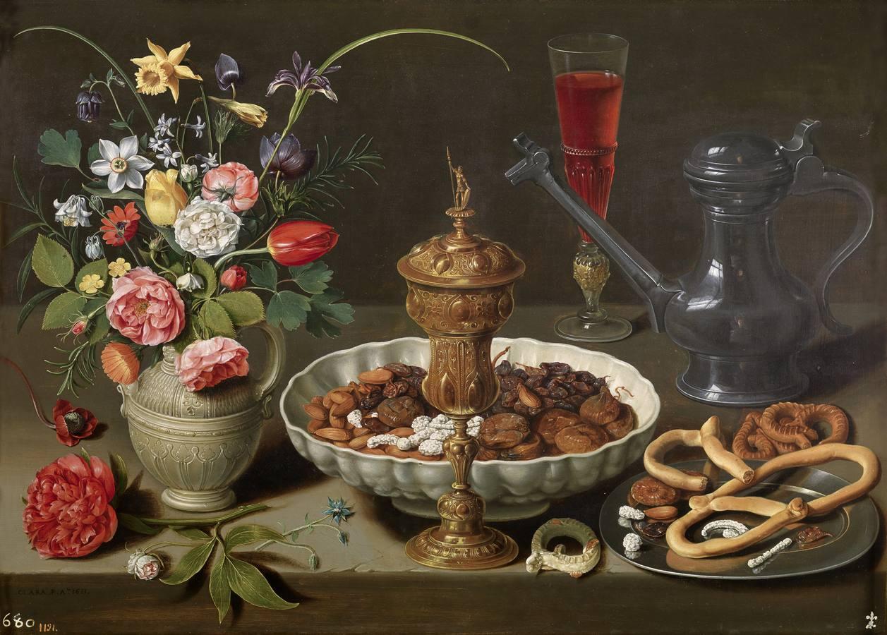 «Bodegón con flores, copa de plata dorada, almendras, frutos secos, dulces, panecillos, vino y jarra de peltre» (1611), de Clara Peeters