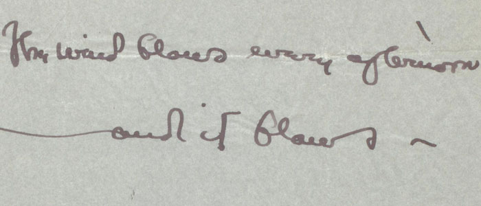 Closeup of a letter that reads, 'The wind blows every afternoon'.