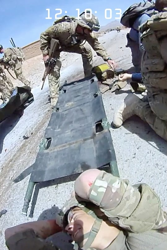 Stretchers arrive to take away the wounded