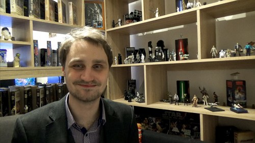 Petr 'Harmy' Harmaek sits in front of his Star Wars collection