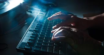 Anonymous person using a computer keyboard