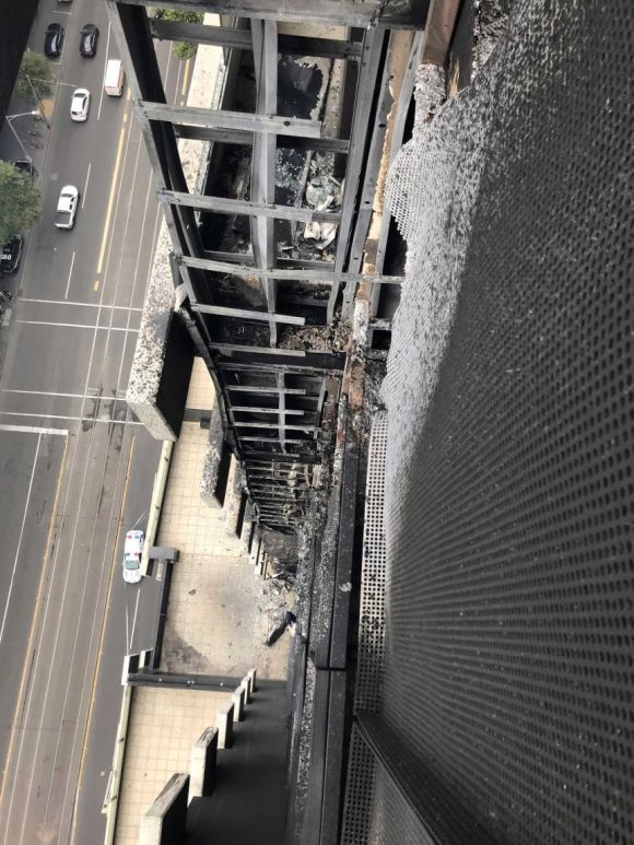 Looking down the side of a  Melbourne apartment building damaged by fire.