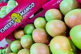 a pink box with mangoes.