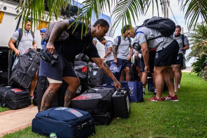 New Zealand Warriors NRL players collect their suitcases after getting off their bus in Terrigal on the central NSW coast.