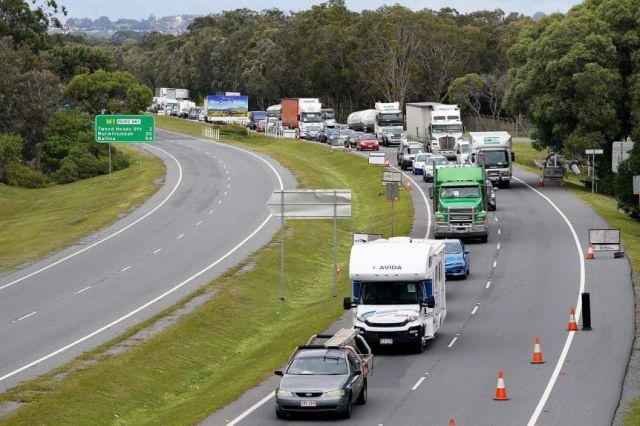 Queue of motorists on the motorway into the Gold Coast approach a checkpoint at Coolangatta on the Queensland-NSW border.