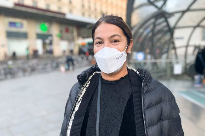 A French commuter in a mask outside a Paris metro station.