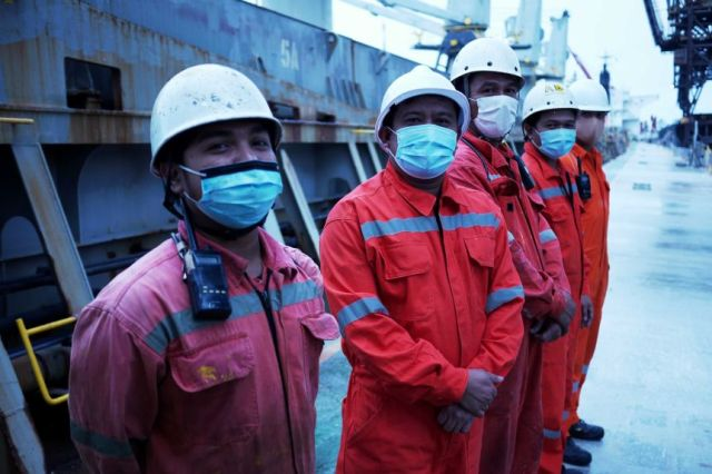 Foreign seafarers onboard a vessel docked at Sydney's Port Botany.