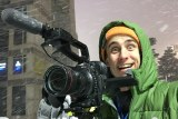 Matt Roberts holding camera with silly look on his face as snow comes down around him.