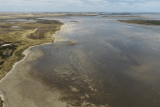 A drone image of the Coorong in South Australia showing the land, sky and the water.