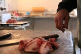 Paul Bennett cutting up the last bits of meat at his butcher.