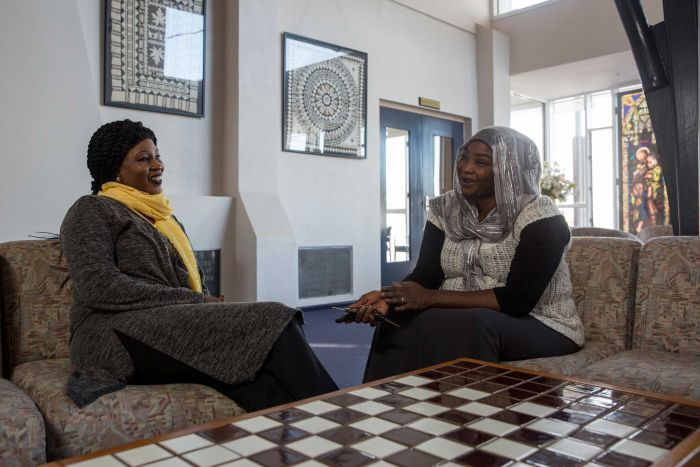 Eglal chats with her friend Fatima during one of the Stand Up group women's meetings in a Dandenong church
