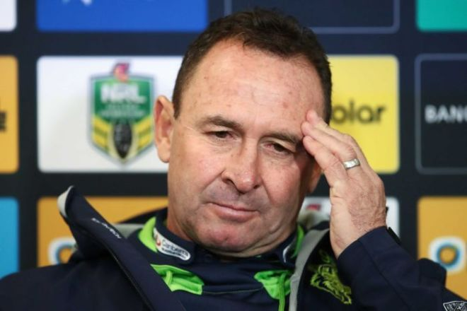 Ricky Stuart stares languidly into the middle distance while rubbing his temple with his left hand during a press conference.