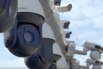 CCTV cameras pointing in a range of different directions are mounted in a row.