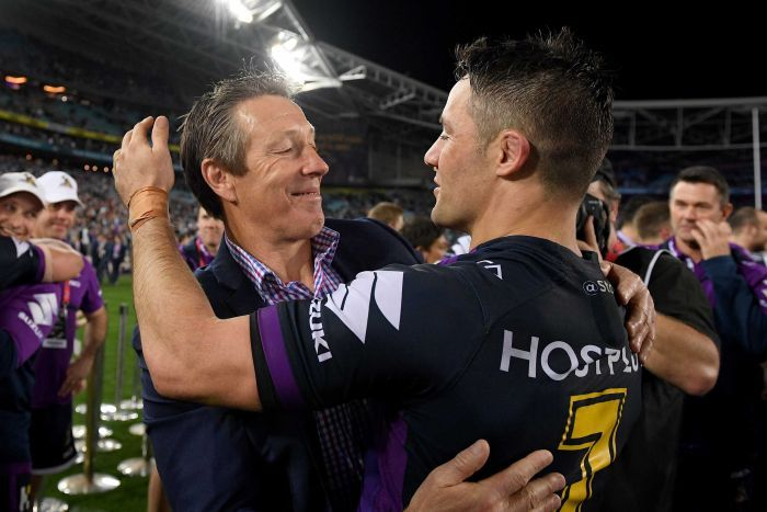 Craig Bellamy and Cooper Cronk hug each other after the 2017 NRL grand final.
