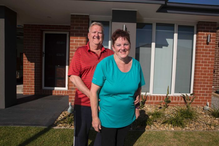 Alan Bolten and Maureen Ansell at the front of their home