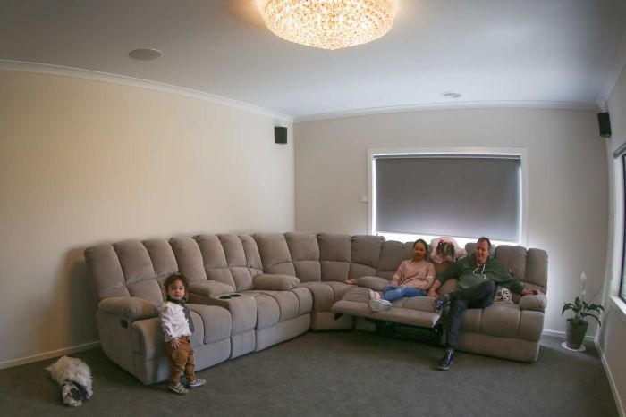 Mickleham family Angelica and Darren Young and their children Lincoln and Chelsea sit on their couch