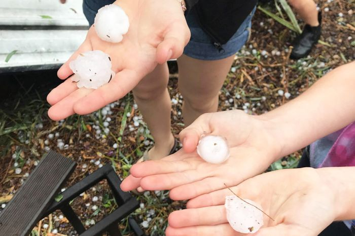 Hail stones held in hands after storm at Kumbria, west of Nanango in southern Queensland.