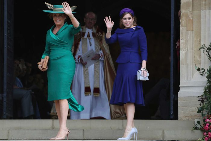 Sarah Ferguson and her daughter Princess Beatrice wave before entering St George's Chapel.
