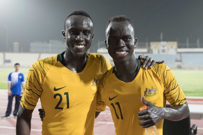 Socceroos players Thomas Deng and Awer Mabil after beating Kuwait.