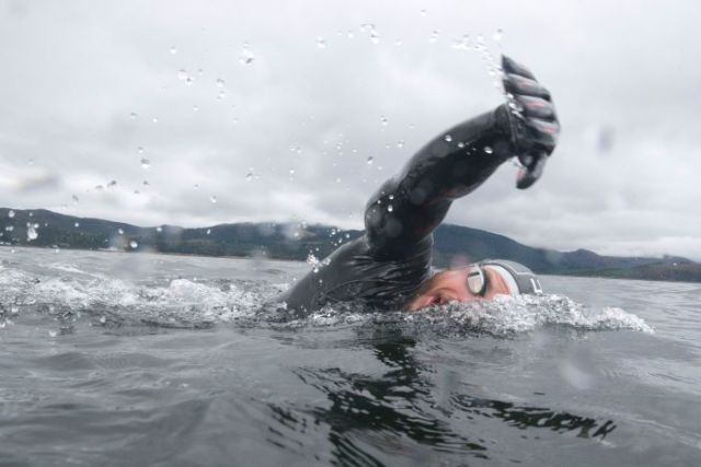Freezing waters off the coast of Scotland proved no barrier to Ross Edgley becoming the first person to swim round Great Britain