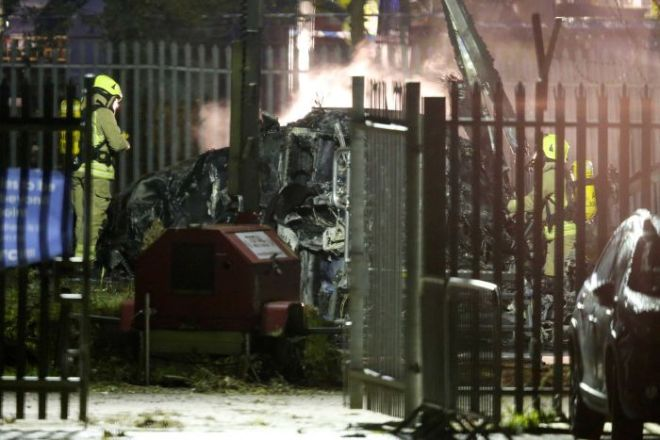Crews attend to helicopter crash outside King Power Stadium