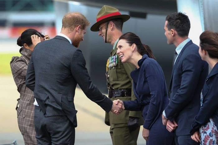 Prince Harry shakes hands with New Zealand PM Jacinda Ardern