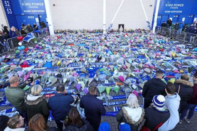 Supporters pay tribute outside Leicester City Football Club after the helicopter crash.