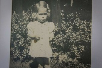 Black and white photo of a little girl.