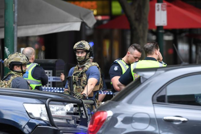 Police are seen at an incident on Bourke Street in Melbourne, Friday, November 9, 2018.