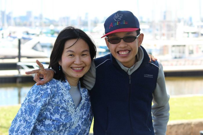 Mother and son in front of boat harbour