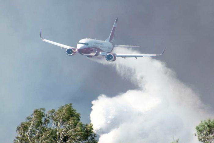 Boeing 737 water bomber dropping water over the catastrophic bushfires in central Queensland.