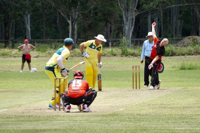 Over 50s Welsh and Australian cricket teams playing