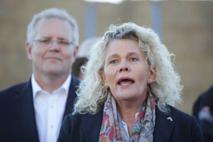 Fiona Simson speaks at a press conference with Prime Minster Scott Morrison watching on over her shoulder