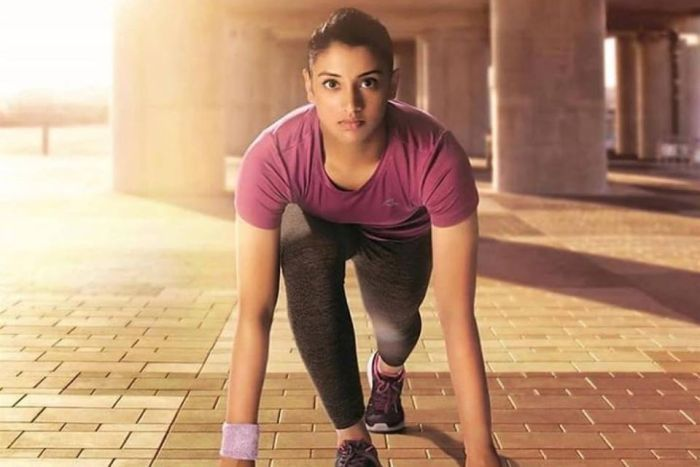 Indian cricketer Smriti Mandhana poses for photo in running gear.