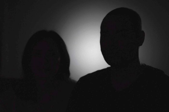 A silhouette of a couple.